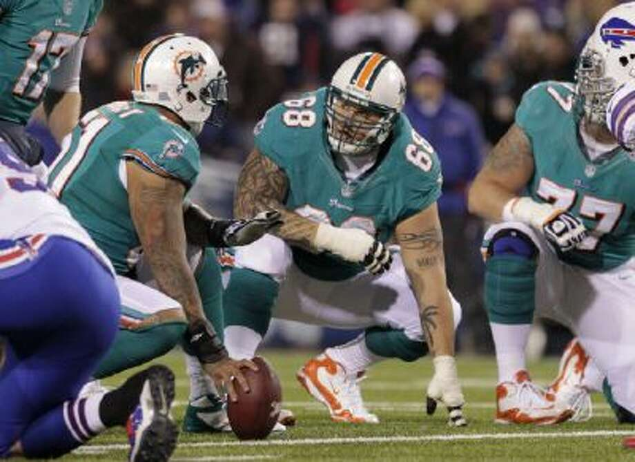 Miami Dolphins' Richie Incognito listens for a signal against the Buffalo Bills during the second half of an NFL football game Thursday, Nov. 15, 2012 in Orchard Park, N.Y.