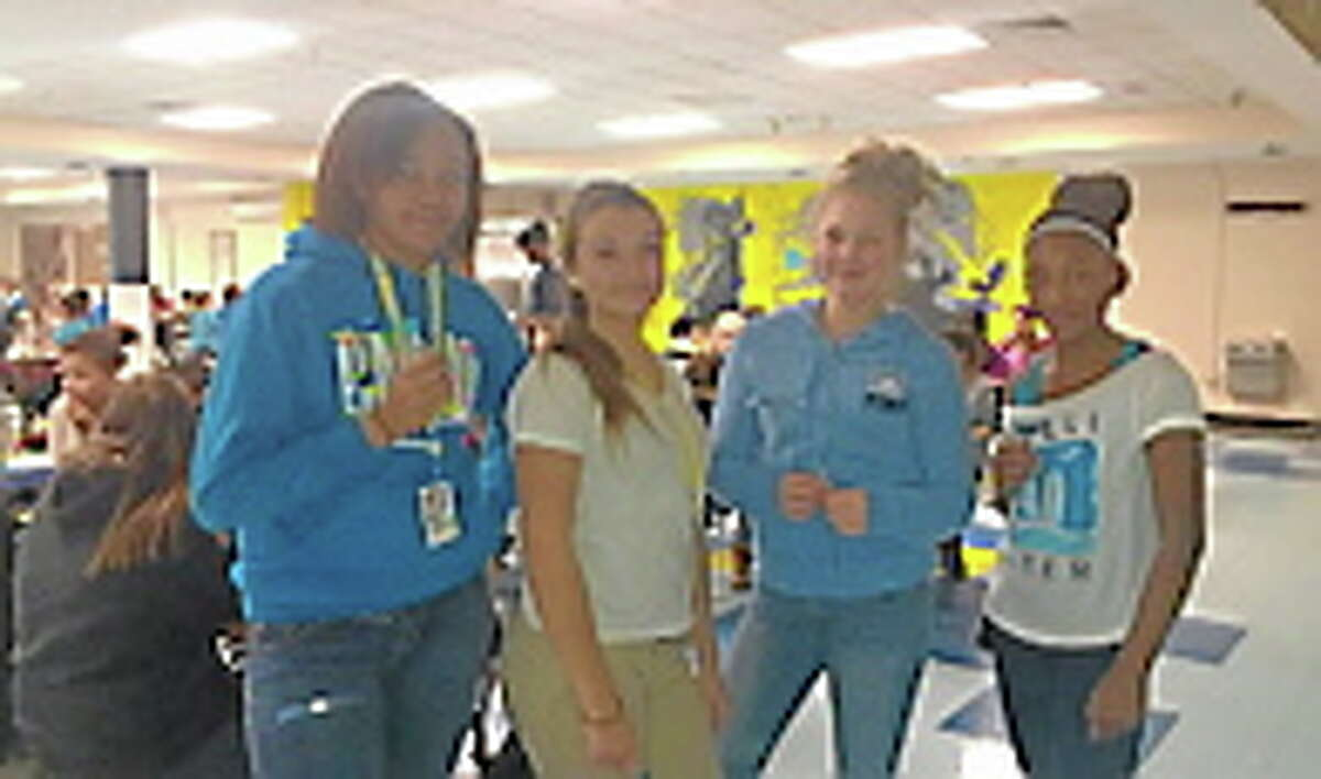 Students last year show Who I Am Makes a Difference Day spirit by wearing blue and displaying their blue ribbons. Submitted photo.