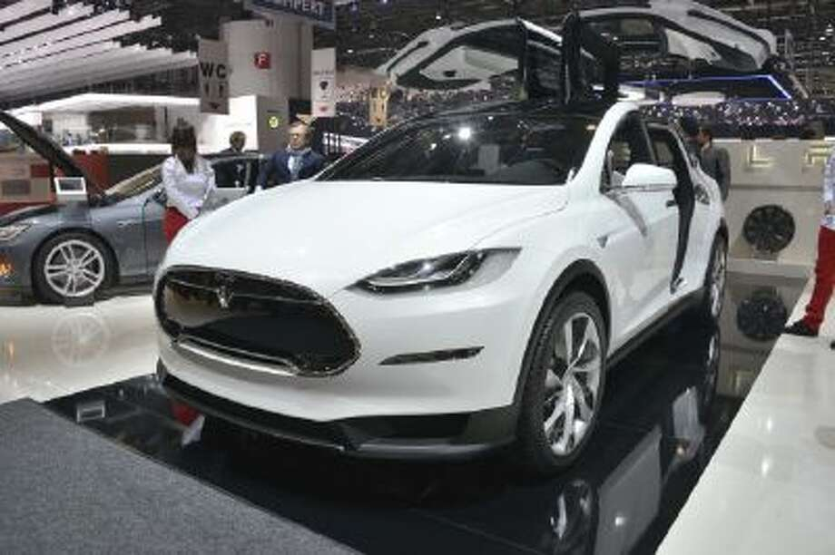 Tesla Model X at the Geneva Motor Show 2013 The company hopes to launch its electric SUV in 2014, followed by its first mass-market car in 2015.