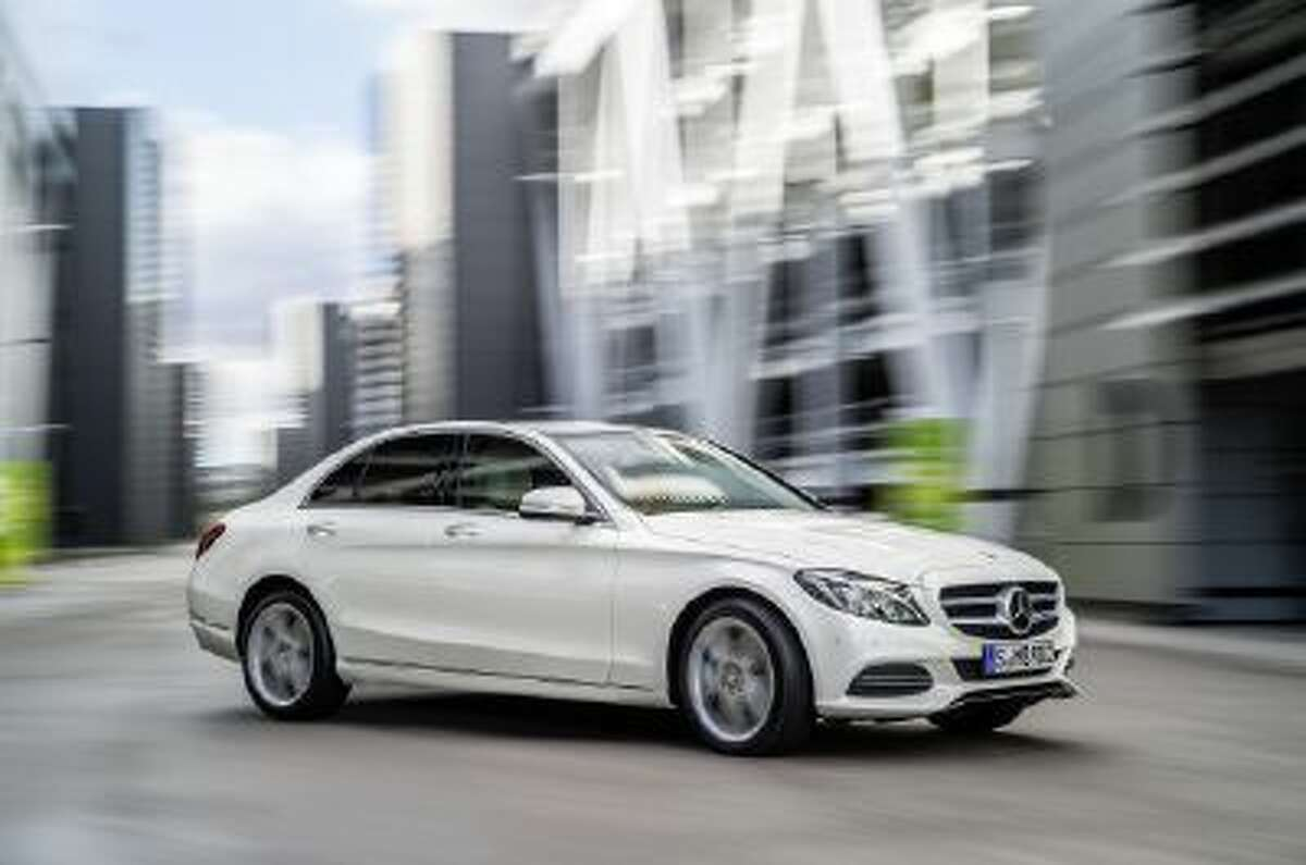 The 2014 Mercedes-Benz C-Class The new car is longer, wider and lighter than its predecessor.