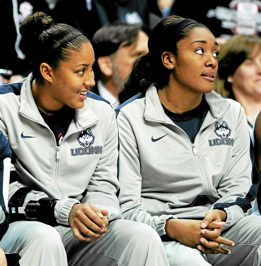 UConn's Kaleena Mosqueda-Lewis, left, and Morgan Tuck are probable for Tuesday's game against Duke after sitting out the last eight games with injuries. Photo: Fred Beckham — The Associated Press  / FR153656 AP