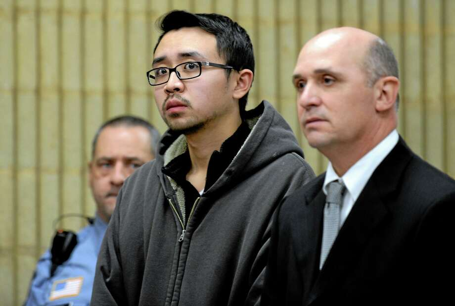 University of New Haven student William Dong, 22, of Fairfield, Conn., with assistant public defender Kevin Williams, right, appears during his arraingment Wednesday, Dec. 4, 2013, at Superior Court in Milford, Conn. Dong, 22, was charged with illegal possession of an assault weapon and other crimes after Tuesday's scare, which led to a a University of New Haven campus lockdown of more than four hours. Police say they don't know why Dong brought guns to the campus. (AP Photo/The Connecticut Post, Autumn Driscoll, Pool) Photo: AP / POOL, The Connecticut Post