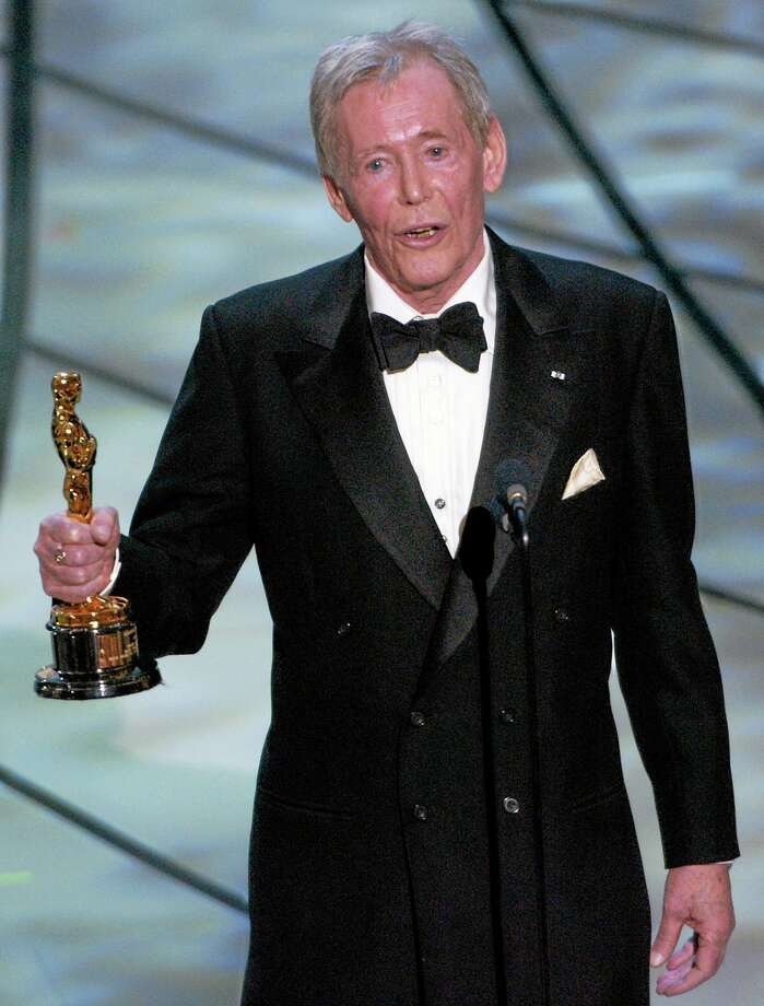 FILE - In this March 23, 2003 file photo, Actor Peter O'Toole accepts his honorary Oscar from the Academy of Motion Picture Arts and Sciences during the 75th annual Academy Awards telecast in Los Angeles. O'Toole, the charismatic actor who achieved instant stardom as Lawrence of Arabia and was nominated eight times for an Academy Award, has died. He was 81. O'Toole's agent Steve Kenis says the actor died Saturday, Dec. 14, 2013 at a hospital following a long illness. (AP Photo/Kevork Djansezian) Photo: AP / AP