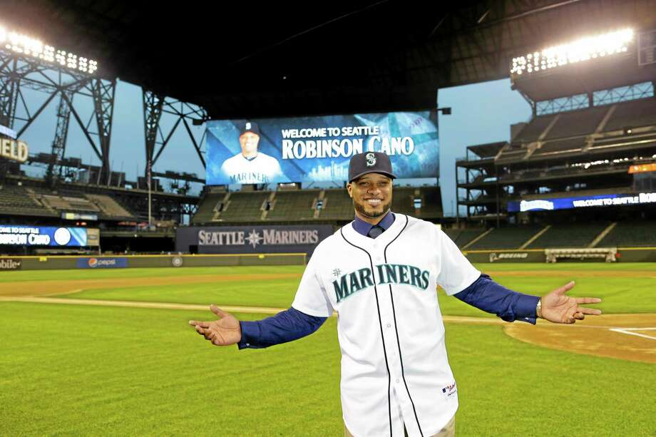 Robinson Cano poses for a photo in his new jersey at Safeco Field after he was introduced as the newest member of the Mariners on Thursday in Seattle. Photo: Ted S. Warren — The Associated Press  / AP