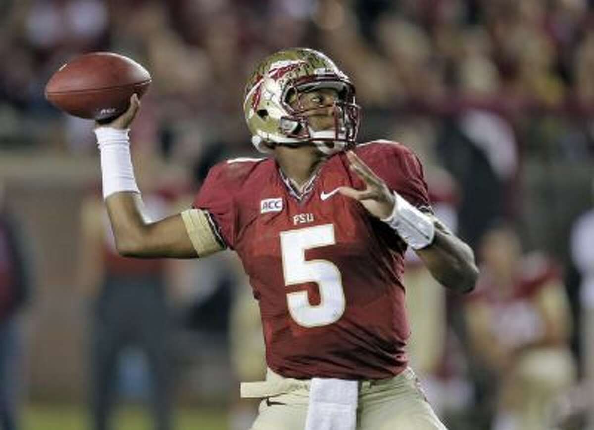 Florida State quarterback Jameis Winston throws a pass during a football game against Miami, in Tallahassee, Fla., on this Nov. 2.