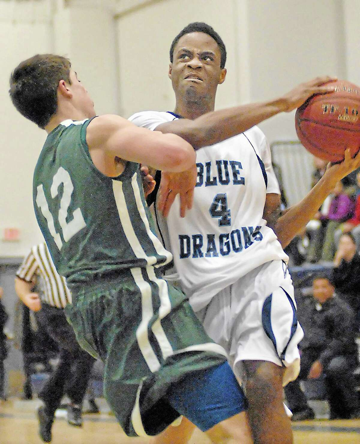 Middletown's Antonio White makes a move against Maloney at the LaBella-Sullivan Gymnasium at MHS last year.
