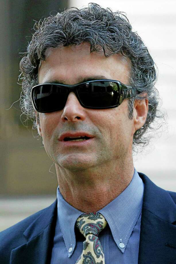 Kurt Mix arrives at the Hale Boggs Federal Building in New Orleans, Tuesday, Dec. 3, 2013. The former BP drilling engineer is charged with deleting text messages and voicemails about the company's response to its massive 2010 oil spill in the Gulf of Mexico. (AP Photo/Jonathan Bachman) Photo: AP / FR170615 AP