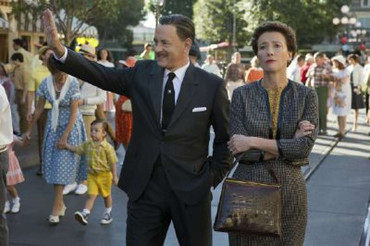This image released by Disney shows Tom Hanks as Walt Disney, left, and Emma Thompson as author P.L. Travers in a scene from
