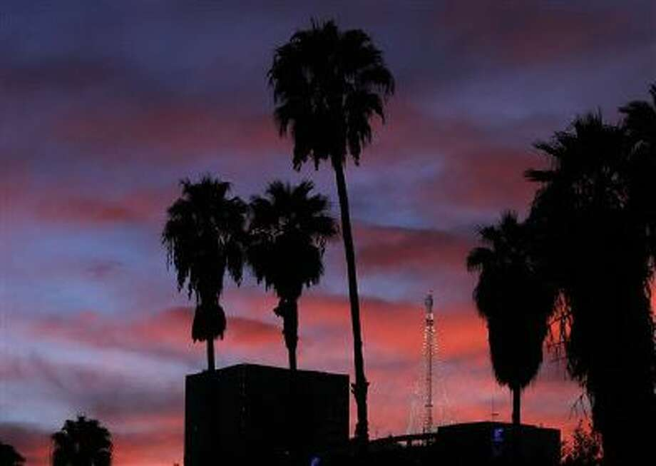 A spectacular sunset covers downtown Los Angeles on Dec. 2. Photo: AP / AP
