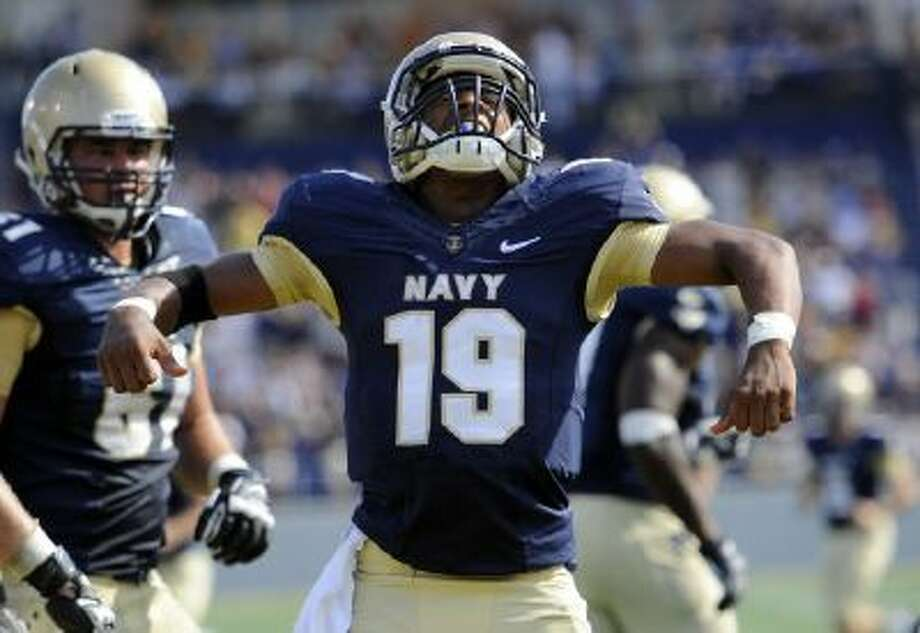 Navy quarterback Keenan Reynolds celebrates after scoring a touchdown in an Oct. 5, 2013 game.
