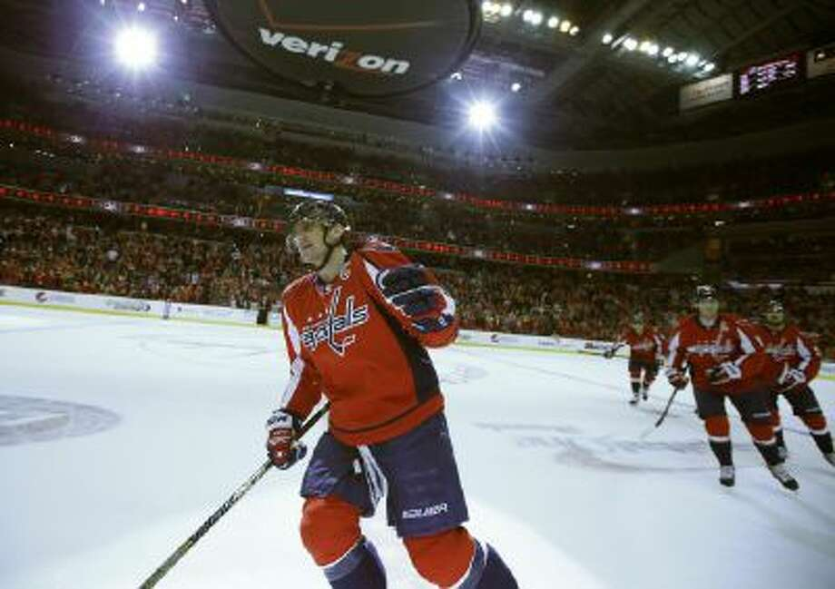 Alex Ovechkin celebrates after his first goal of four scored against the Tampa Bay Lightning.