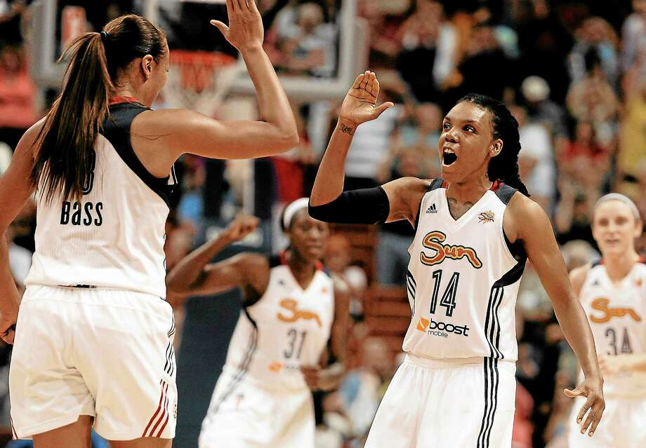 The Connecticut Sun's Tan White, right, and Mistie Bass will welcome aboard the No. 1 pick in the next WNBA Draft, which the Sun were awarded during the lottery on Tuesday night. Photo: Jessica Hill - The Associated Press  / A2013