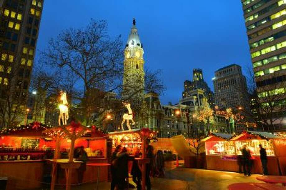 A variety of treats are offered at the Christmas Village in Philadelphia, which is in its sixth year; in the village, elfin structures occupied by more than 60 retailers encircle the 38-foot-tall Christmas tree in Love Park.