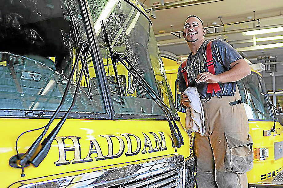 Olivia Drake - Special to the Press Haddam Volunteer Fire Co. probationary member Mike Mancuso keeps the fire trucks clean and ready for the next call. The fire department is looking for new members. Photo: Journal Register Co.