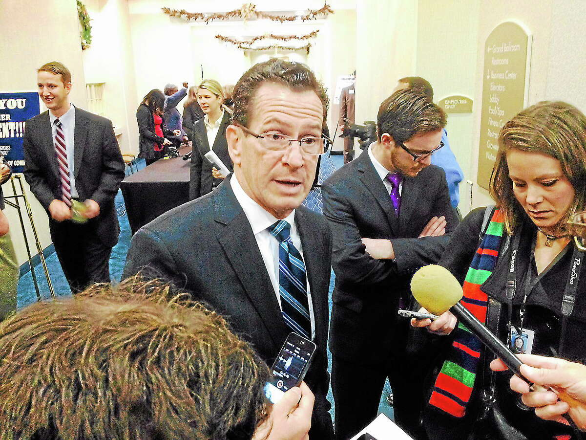 Gov. Dannel P. Malloy speaks about small business and other initiatives for next year at Tuesday's Middlesex Chamber of Commerce breakfast meeting in Cromwell.