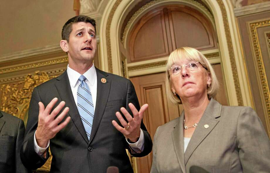 FILE - This Oct. 17, 2013 file photo shows House Budget Committee Chairman Rep. Paul Ryan, R-Wis., left, and Senate Budget Committee Chair Patty Murray, D-Wash., on Capitol Hill in Washington. Bipartisan budget negotiators are working toward a modest budget agreement to replace tens of billions of dollars in spending cuts this year and next with longer-term savings and revenue from increased fees. Ryan and Murray are hopeful of striking an agreement as early as Tuesday afternoon. (AP Photo/ Scott Applewhite, File) Photo: AP / AP