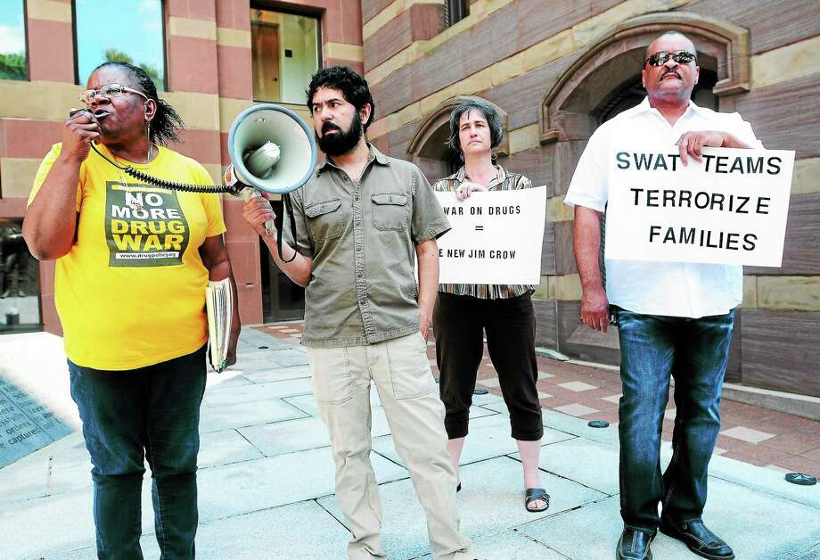 Barbara Fair, left, speaks at a protest about the War on Drugs in front of CIty Hall in New Haven. Left to right are Fair, John Lugo, Tisa Wenger and Robert Lee. Photo: Arnold Fair — New Haven Register