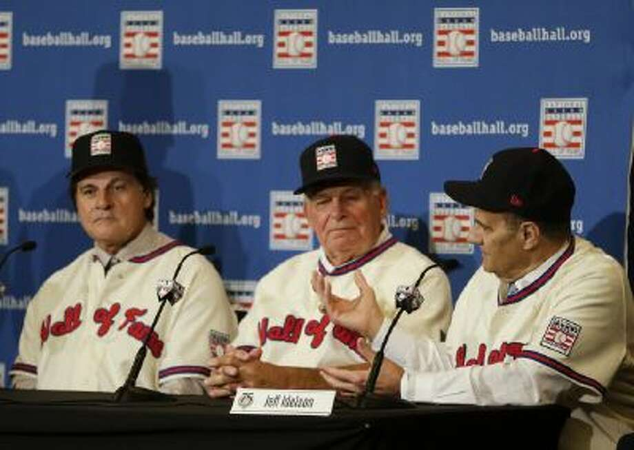 Joe Torre, far right, speaks at a news conference with Tony La Russa, left, and Bobby Cox after it was announced the retired managers were unanimously elected to the baseball Hall of Fame during the MLB winter meetings in Lake Buena Vista, Fla., Monday, Dec. 9, 2013.
