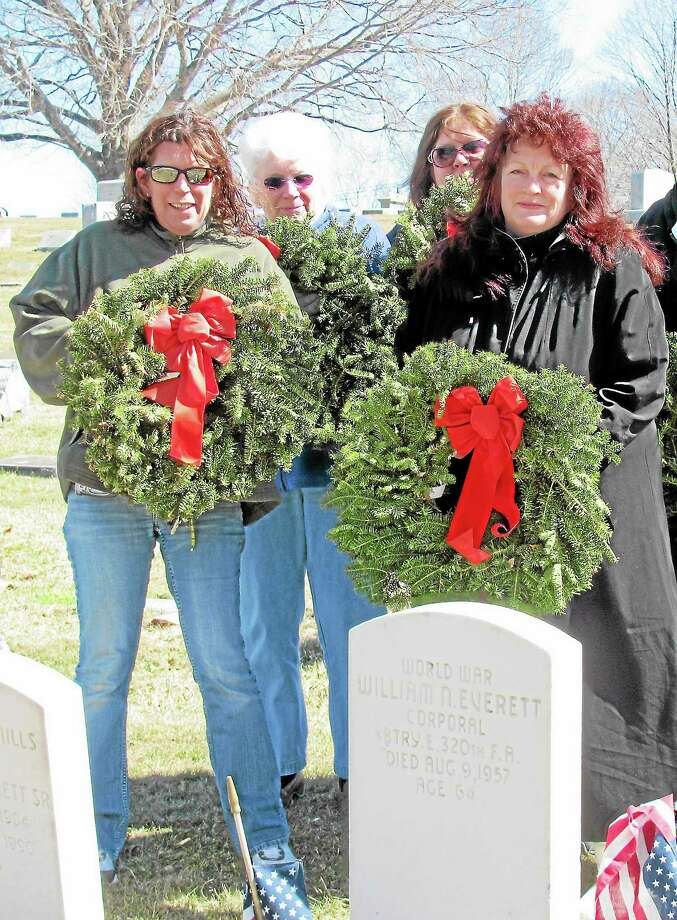 East Hampton VFW Post 5059 Ladies Auxiliary wreath-laying volunteers at Lake View Cemetery are left to right Donna McLaughlin, Ann McLaughlin (also town leader of the Yellow Ribbon Campaign), Kathy Fuller (in the back) and Sherry Visintainer. Photo: Submitted Photo By Linda Wallace