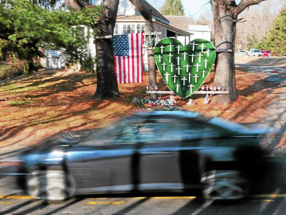 (Peter Hvizdak — New Haven Register)A memorial for Sandy Hook School shooting victims on Riverside Road near Dickenson Drive in Sandy Hook Wednesday, December 4, 2013 Road. Photo: New Haven Register / ©Peter Hvizdak /  New Haven Register