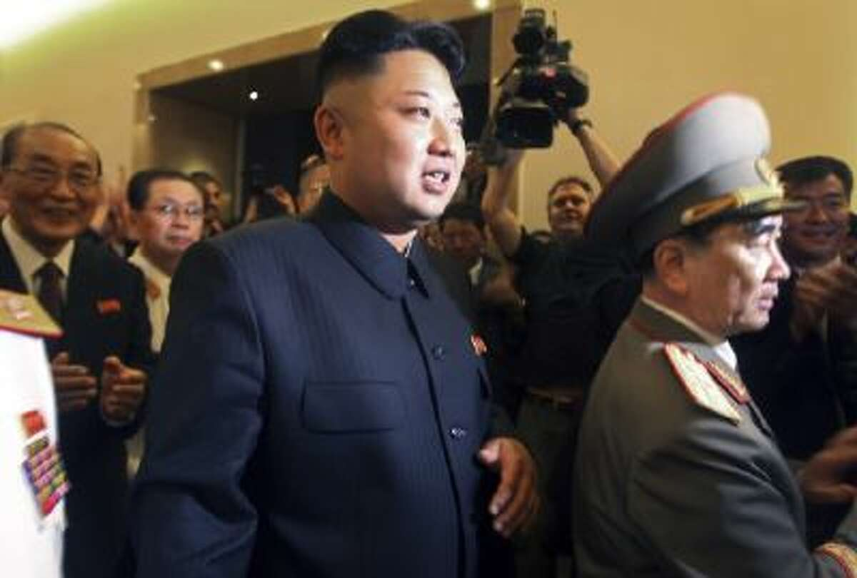 North Korean leader Kim Jong Un, center, flanked by Yang Hyong Sop, Vice President of the Presidium of North Korea's parliament to his left tours the newly opened Fatherland Liberation War Museum, Saturday, July 27, 2013 as part of celebrations for the 60th anniversary of the Korean War armistice in Pyongyang, North Korea.