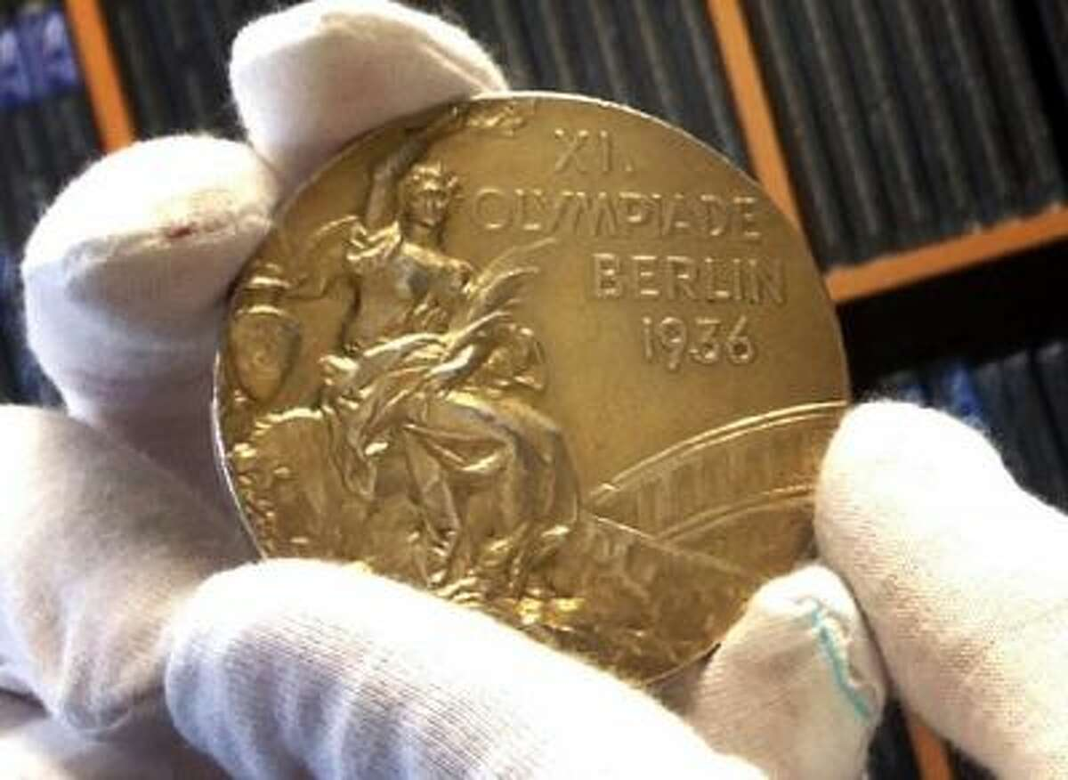 This Nov. 19, 2013 photo shows track and field star Jesse Owens' gold medal is displayed from his 1936 Olympics win at the SCP Auctions in Laguna Nigel, Calif. One of the four Olympic gold medals won by Owens at the 1936 Berlin Games is set to go on the auction block. SCP Auctions says the medal could sell for upward of $1 million in the online auction that runs from through Dec. 7, 2013.