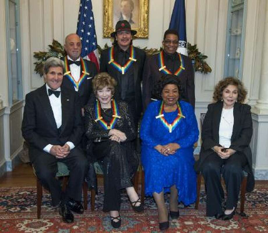 Secretary of State John Kerry, with the 2013 Kennedy Center honorees, from left, seated Shirley MacLain, and Martina Arroyo, along with Teresa Heinz Kerry.