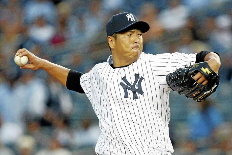 New York Yankees starter Hiroki Kuroda is returning for a third season with the Bombers. Photo: John Minchillo — The Associated Press  / FR170537 AP