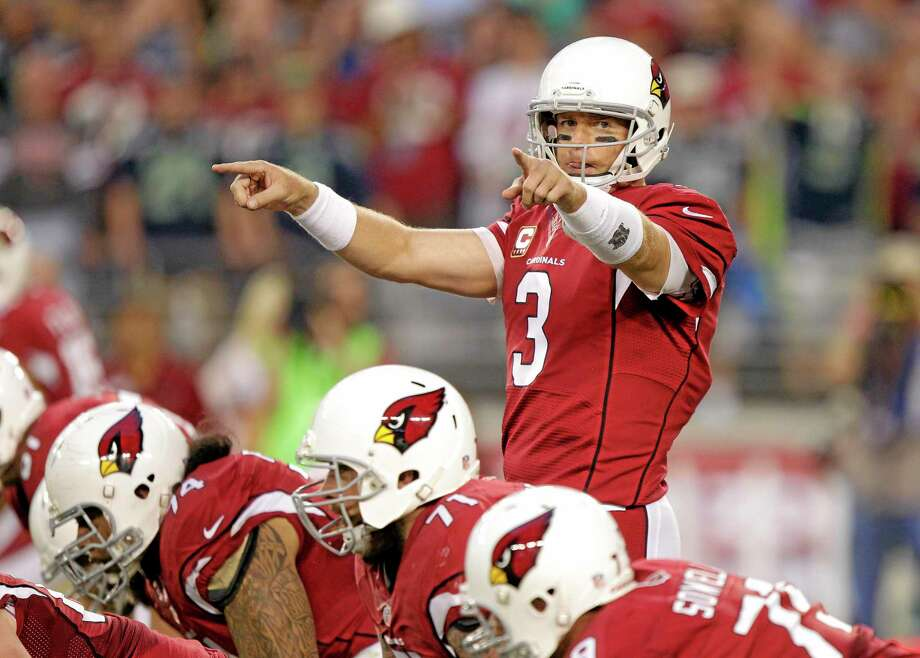 The Register's Dan Nowak likes quarterback Carson Palmer and the Arizona Cardinals to take care of the Rams rather easily today. Photo: Rick Scuteri — The Associated Press  / FR157181