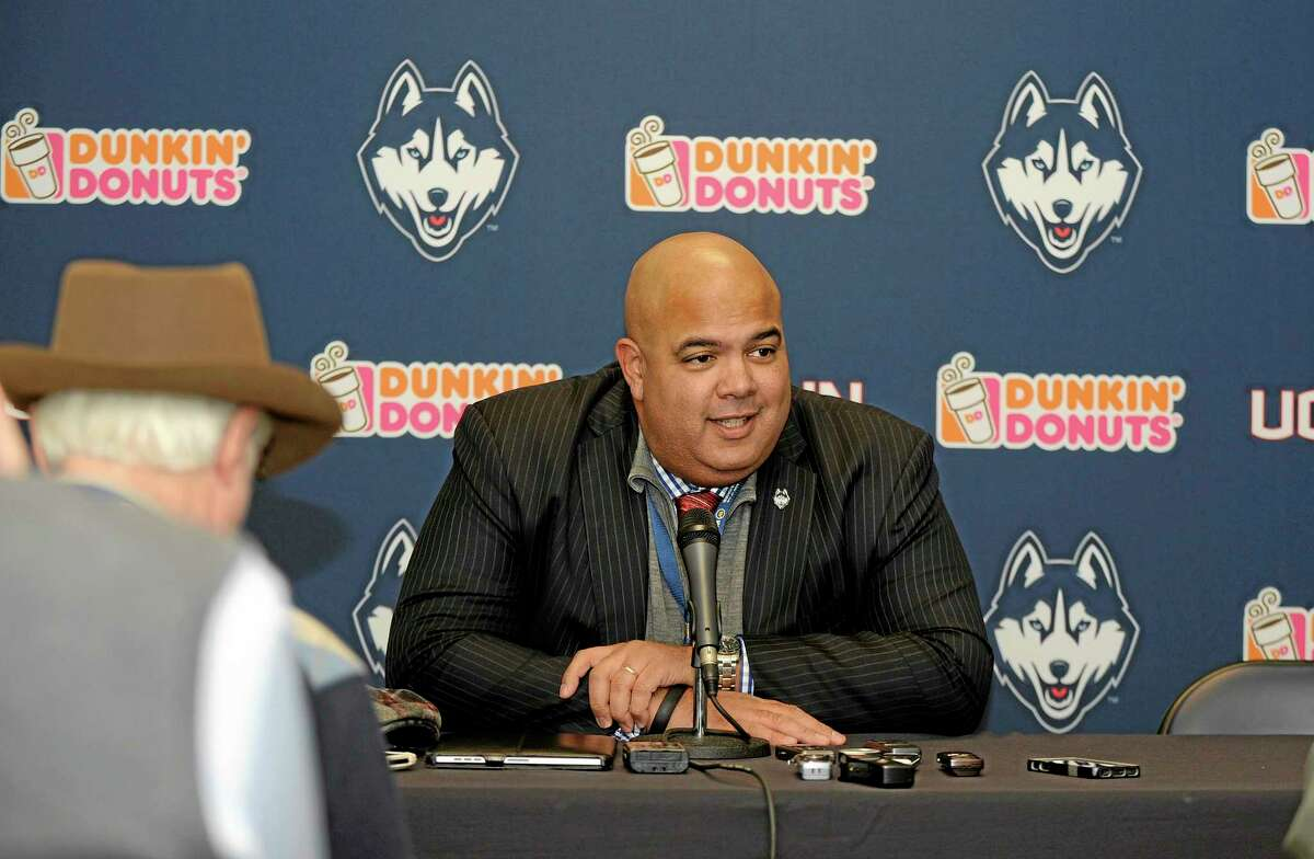 UConn athletic director Warde Manuel speaks to the press before Saturday's game against Memphis at Rentschler Field in East Hartford.