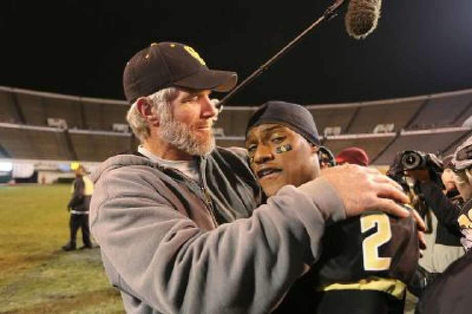 Brett Favre, the offensive coordinator at Oak Grove High School, embraces wide receiver Jordan Duncan after the Warriors won the MHSAA Class 6A State Championship Friday Dec. 6 in Jackson, Miss.