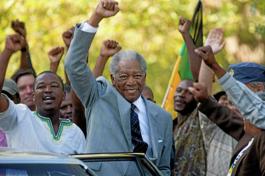 "In this film publicity image released by Warner Bros., Morgan Freeman portrays Nelson Mandela in a scene from, ""Invictus.""  Heroic in his deeds, graceful in his manner, sainted in his image, Nelson Mandela long served as both cause and muse in the entertainment community. From the 1960s, when he was a political prisoner and South Africa was under the laws of apartheid, right up to recent times, when the racist laws of the land had fallen and he was among the world's most admired people, Mandela inspired concerts, songs, poems, fiction and movies.(AP Photo/Warner Bros., Keith Bernstein) Photo: AP / Warner Bros."