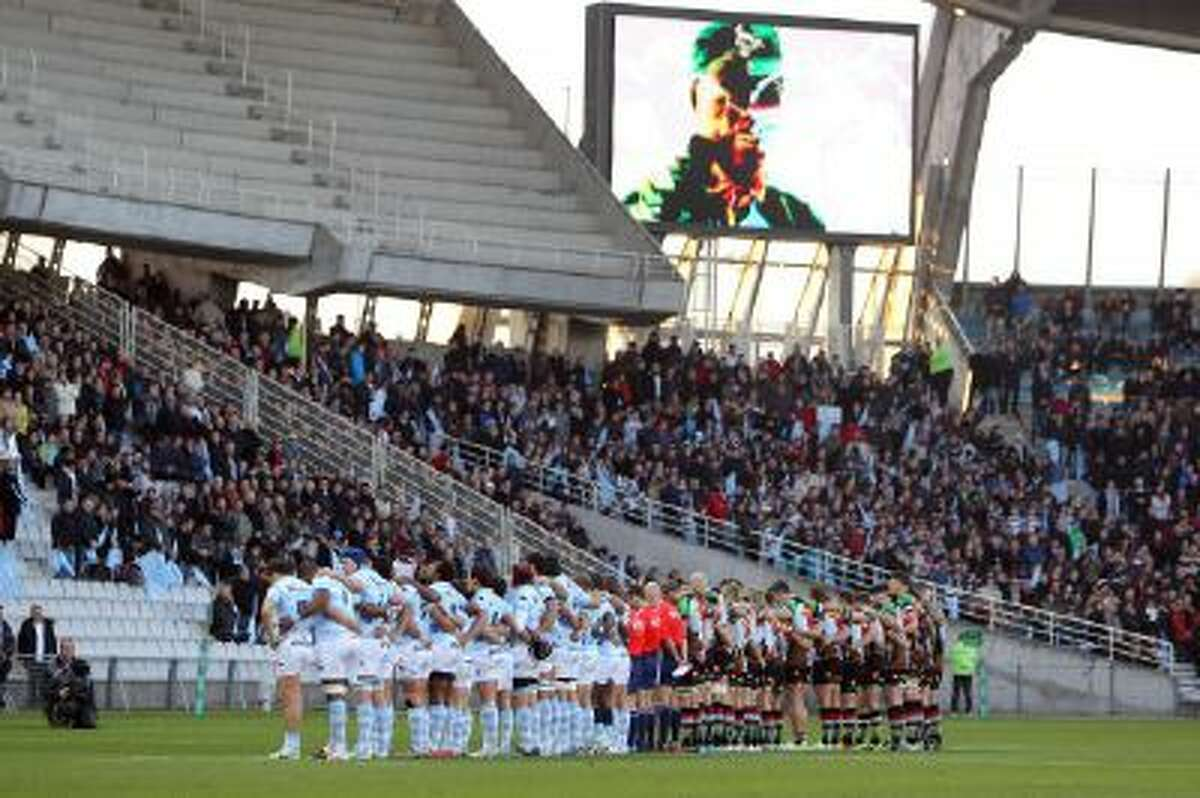 A moment of silence in honor of former South African President Nelson Mandela, who died Thursday, is observed before Paris Racing Metro 92 and Britain?s Harlequins play an Heineken Cup rugby game, Saturday, Dec. 7, 2013, at Nantes? La Beaujoire stadium, western France.