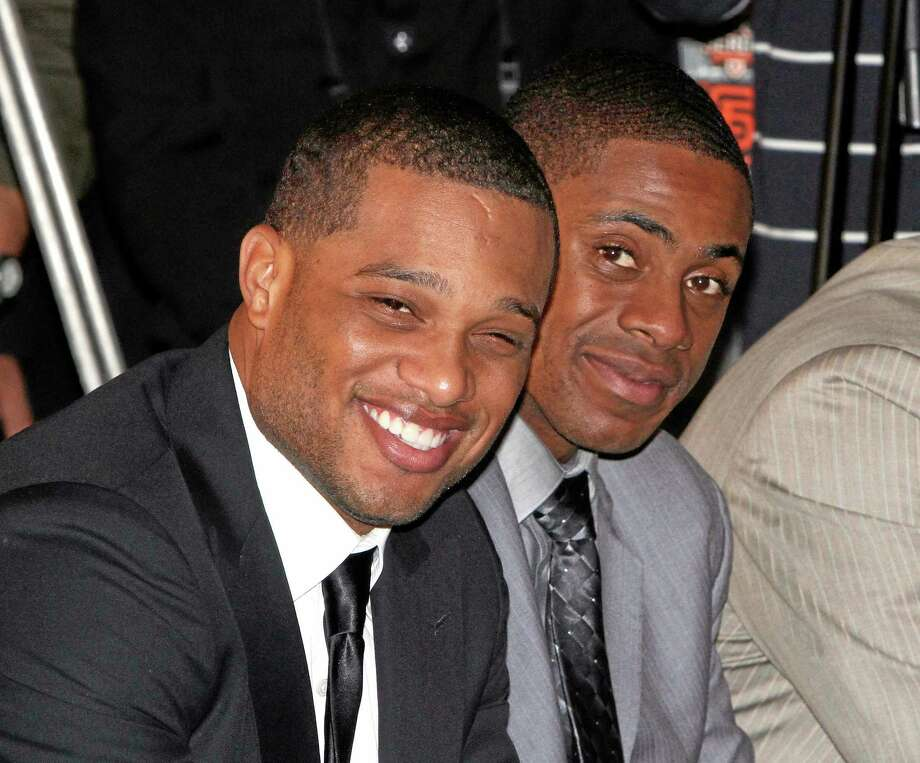 In this Oct. 30, 2011 file photo, Robinson Cano of the New York Yankees, left, and teammate Curtis Granderson smile during a press conference for a series in Taipei, Taiwan. Cano signed with the Seattle Mariners on Friday and Granderson joined the New York Mets. Photo: Chiang Ying-ying - The Associated Press  / AP