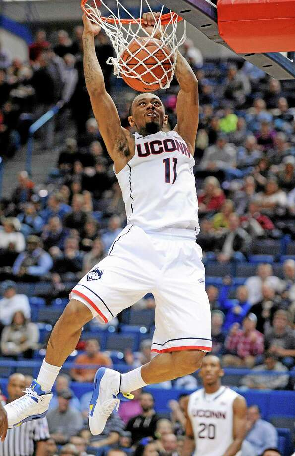 UConn's Ryan Boatright scores two of his team-high 17 points during the first half of the 12th-ranked Huskies' 95-68 victory over Maine on Friday night at the XL Center in Hartford. Photo: Fred Beckham — The Associated Press  / FR153656 AP