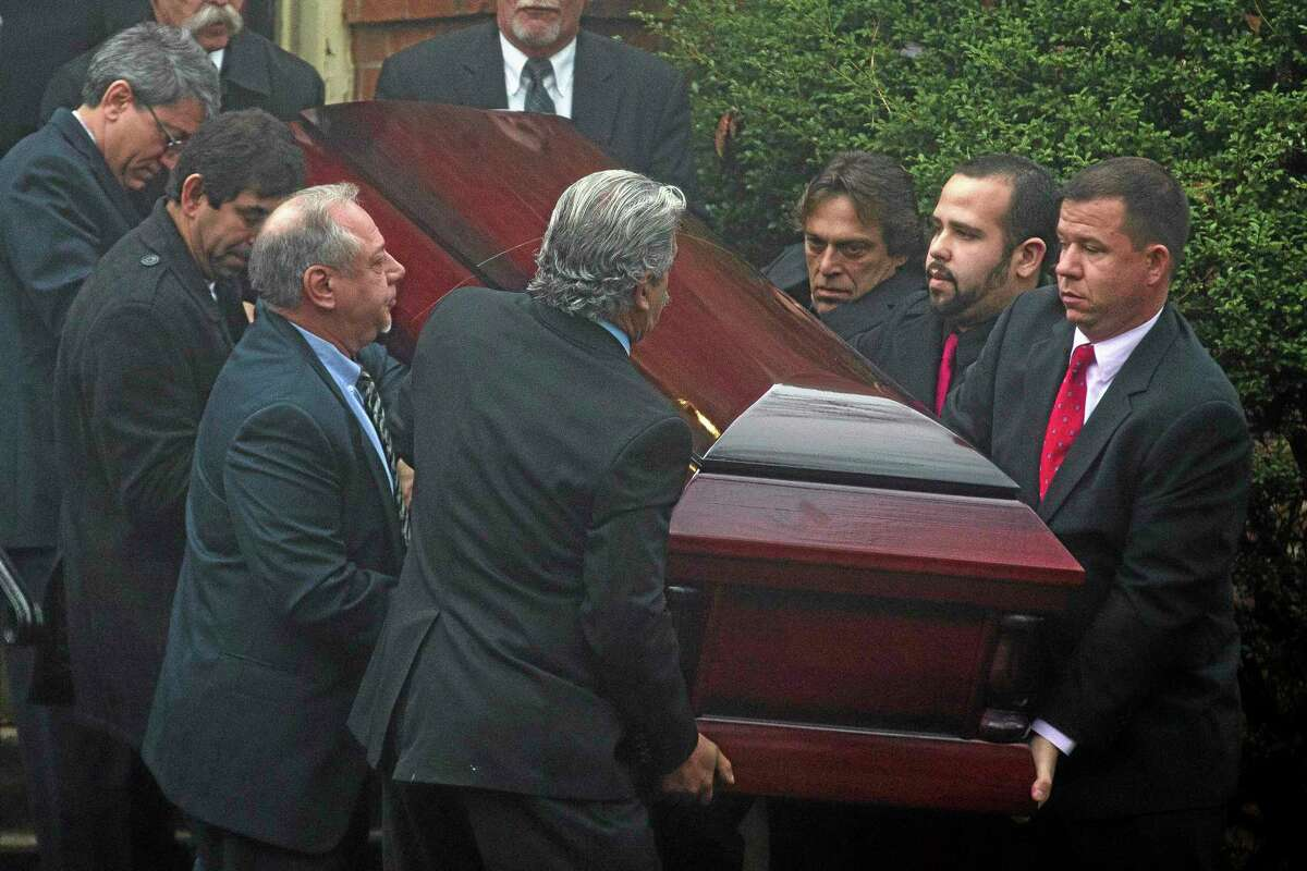 The casket of James Ferrari is carried out the Church of the Divine Love following funeral services, Thursday, Dec. 5, 2013, in Montrose, N.Y. Ferrari, 59, was killed along with three others when a speeding Metro-North Railroad train on the Hudson Line derailed in New York. (AP Photo/John Minchillo)