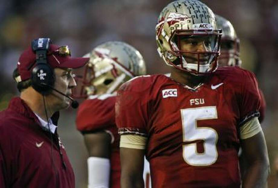 Florida State quarterback Jameis Winston (5) look on from the sidelines during the first half against Idaho.