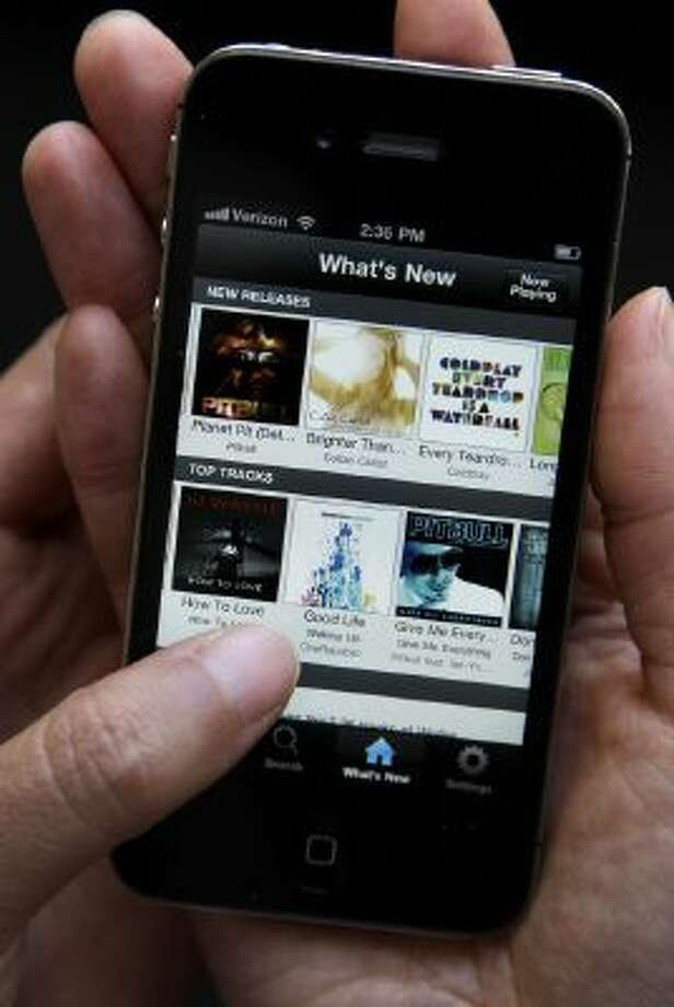 An Associated Press reporter demonstrates Spotify during a product review in San Francisco, Tuesday, July 19, 2011.
