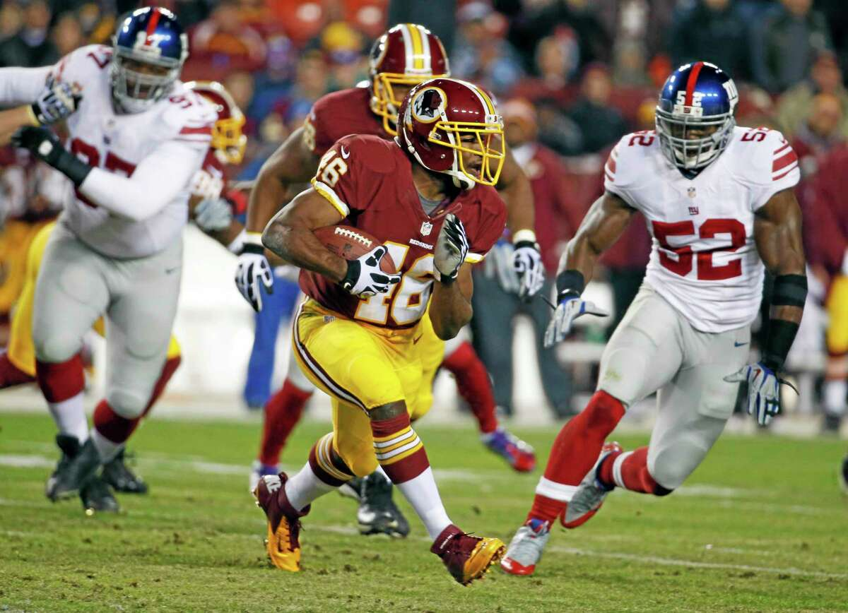 New York Giants middle linebacker Jon Beason (52) chases down Washington Redskins running back Alfred Morris during Sunday's game. Beason is chasing down a big contract too after his solid play this season.