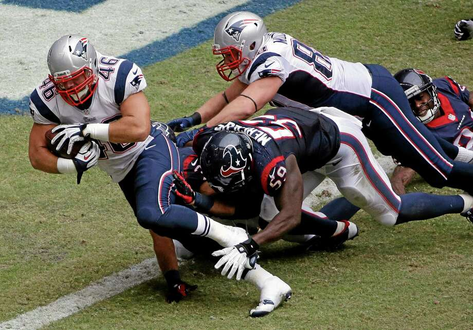New England Patriots fullback James Develin scores a touchdown against the Texans on Sunday in Houston. Photo: David J. Phillip — The Associated Press  / AP