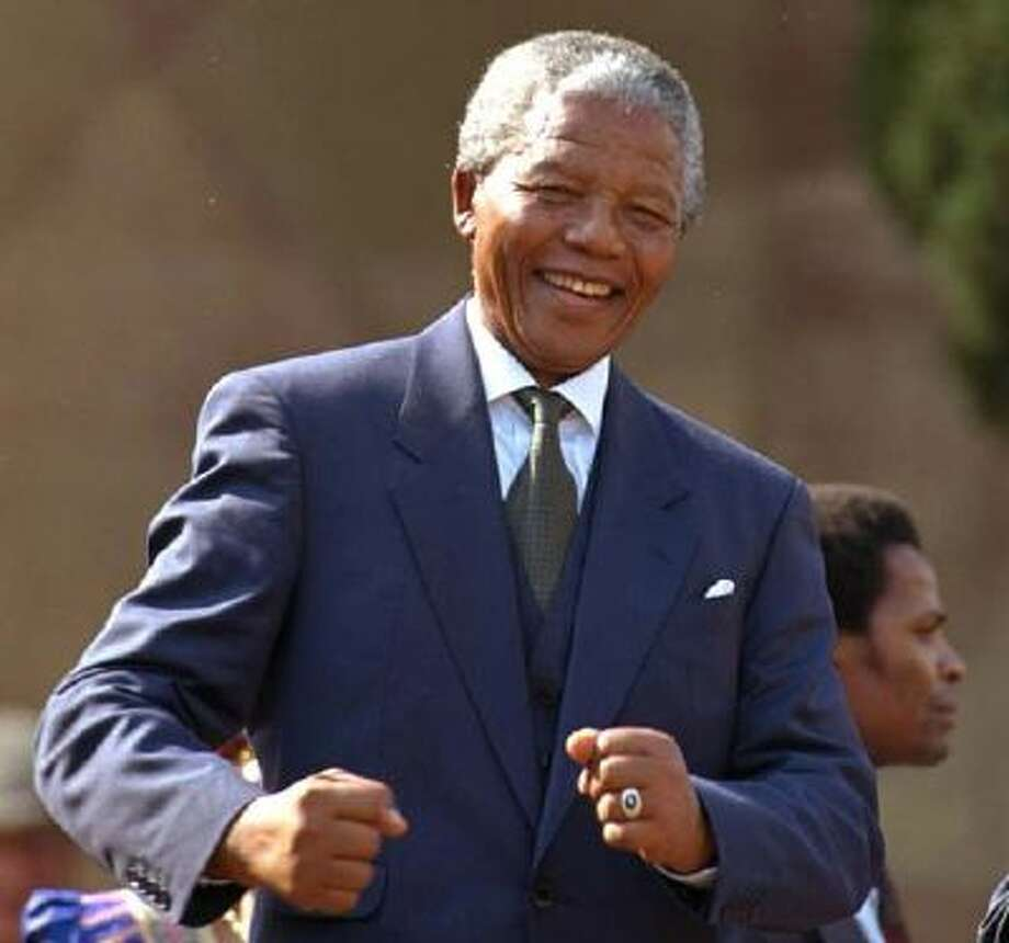 Nelson Mandela dances at a concert following his inauguration. / AP1994