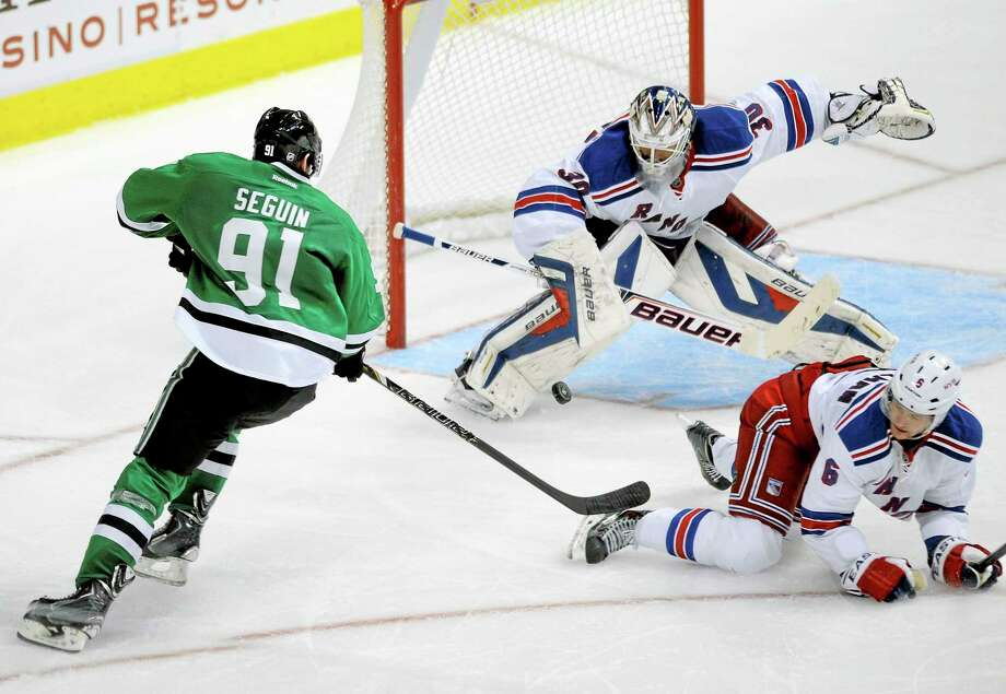 New York Rangers goalie Henrik Lundqvist (30), here making the stop on a shot by Dallas Stars center Tyler Seguin, has agreed to a contract extension. Photo: Matt Strasen — The Associated Press  / FR170476 AP