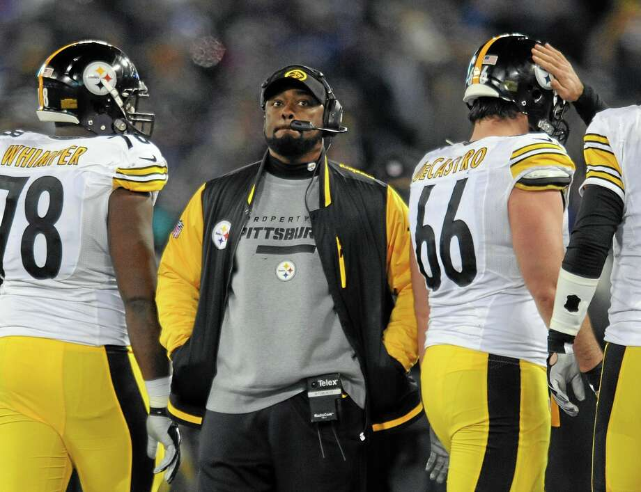 """Pittsburgh Steelers coach Mike Tomlin has been fined $100,000 for interfering with a play against the Baltimore Ravens on Thanksgiving. The NFL also said Wednesday that it would consider docking Pittsburgh a draft pick """"because the conduct affected a play on the field."""" Photo: Gail Burton — The Associated Press  / FR4095 AP"""