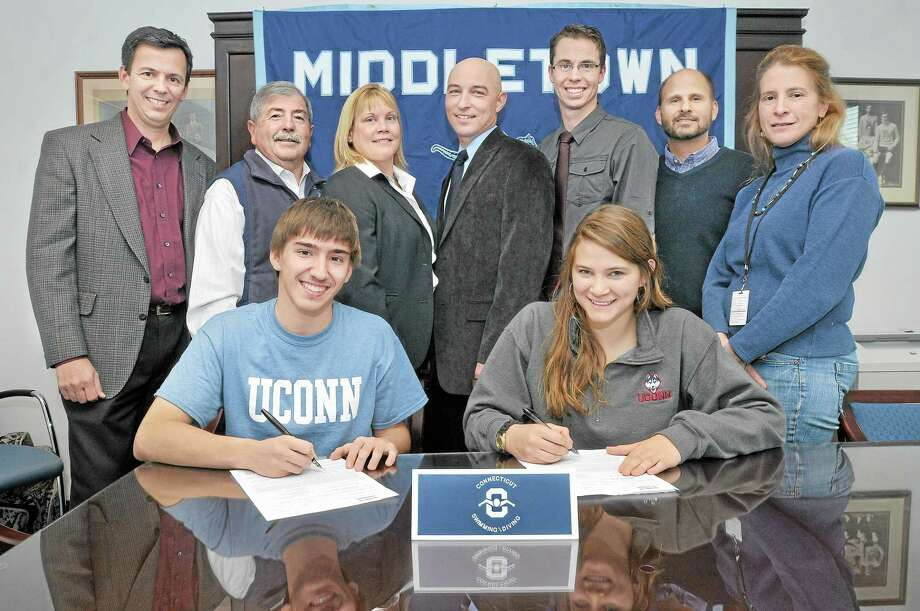 Seniors Dan Kinney, 17 and Monica Marcello, 17, divers on the Middletown High School Swim & Dive Team signed a National Letter of Intent Wednesday afternoon to dive at UCONN next year. Pictured with Kinney and Marcello are, from left, Erin Kinney, Athletic Director Michael Pitruzzello, Principal Colleen Weiner, Dive team coach Matt Quinn, Swim team coach Trevor Charles, Pete and Claudia Marcello. Photo: Catherine Avalone — The Middletown Press  / TheMiddletownPress