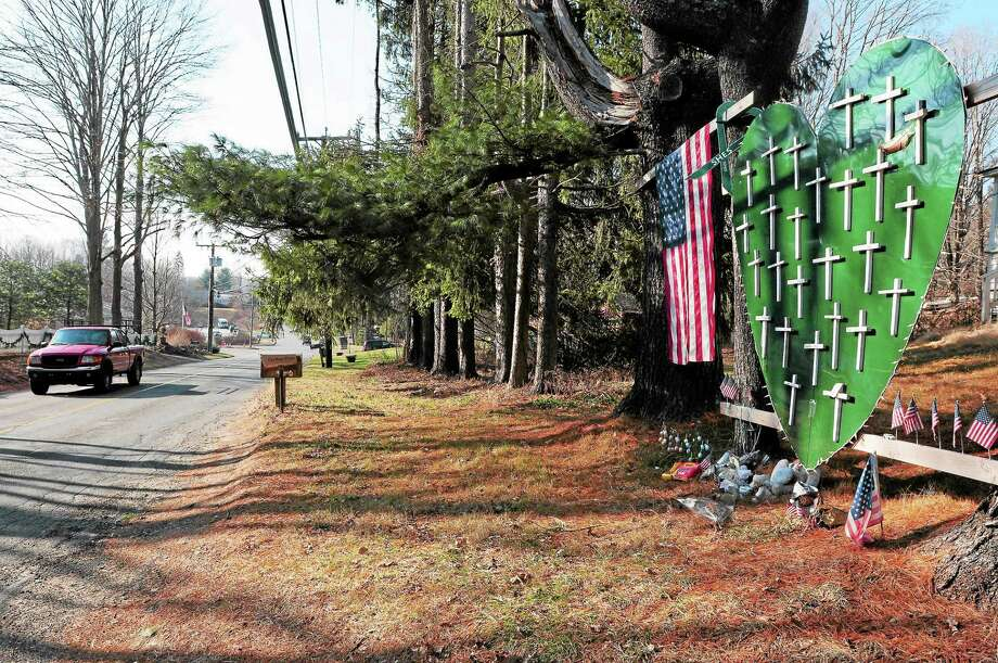 A memorial for Sandy Hook Elementary School shooting victims on Riverside Road near Dickenson Drive in Newtown Wednesday. Photo: Peter Hvizdak — New Haven Register  / ©Peter Hvizdak /  New Haven Register