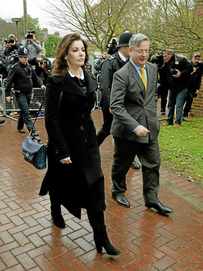 Celebrity chef, Nigella Lawson, left,  arrives at Isleworth Crown Court in London, Wednesday, Dec. 4, 2013. Celebrity chef Nigella Lawson could face questions Wednesday about alleged drug use when she appears as a witness at the fraud trial of her former personal assistants.  Lawson is due to testify as a prosecution witness against Italian sisters Elisabetta and Francesca Grillo. The pair are accused of living the high life by using credit cards loaned to them by Lawson and her ex-husband Charles Saatchi.  (AP Photo/PA, Andrew Matthews) UNITED KINGDOM OUT NO SALES NO ARCHIVE Photo: AP / PA