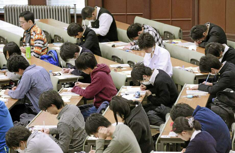 In this January 2013 photo, preparatory students sit for National Center Test for University Admissions at the University of Tokyo. Students from Shanghai, Hong Kong, Singapore, Taiwan, Japan and South Korea were among the highest-ranking groups in math, science and reading in test results released Tuesday, Dec. 3, 2013 by the Program for International Student Assessment (PISA) coordinated by the Paris-based Organization for Economic Cooperation and Development (OECD). The group tests students worldwide every three years. In Japan, the government added 1,200 pages to elementary school textbooks after its children fell behind in those in rivals such as South Korea and Hong Kong in 2009, although Japan's scores for 2009 were tops for rich industrialized countries. Japan has since improved its standings in all three areas. (AP Photo/Kyodo News) JAPAN OUT, CREDIT MANDATORY Photo: AP / Kyodo News