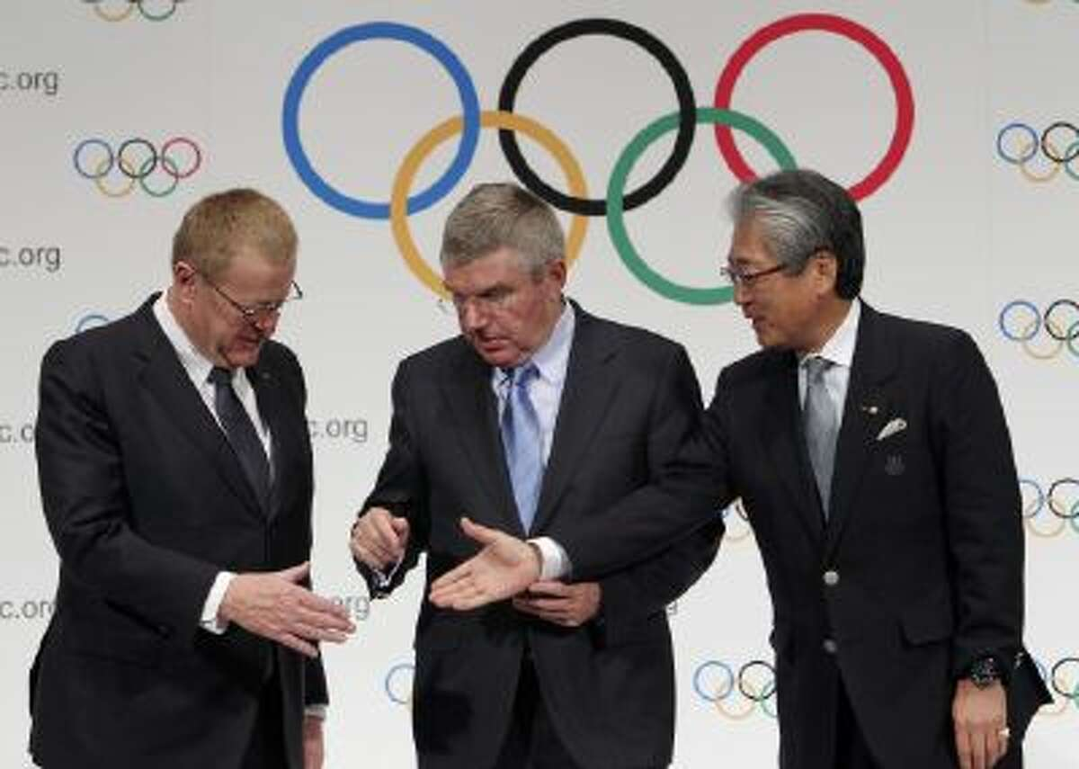 International Olympic Committee (IOC) President Thomas Bach, center, will travel to Brazil to check in on the country's World Cup and Olympic preparations.