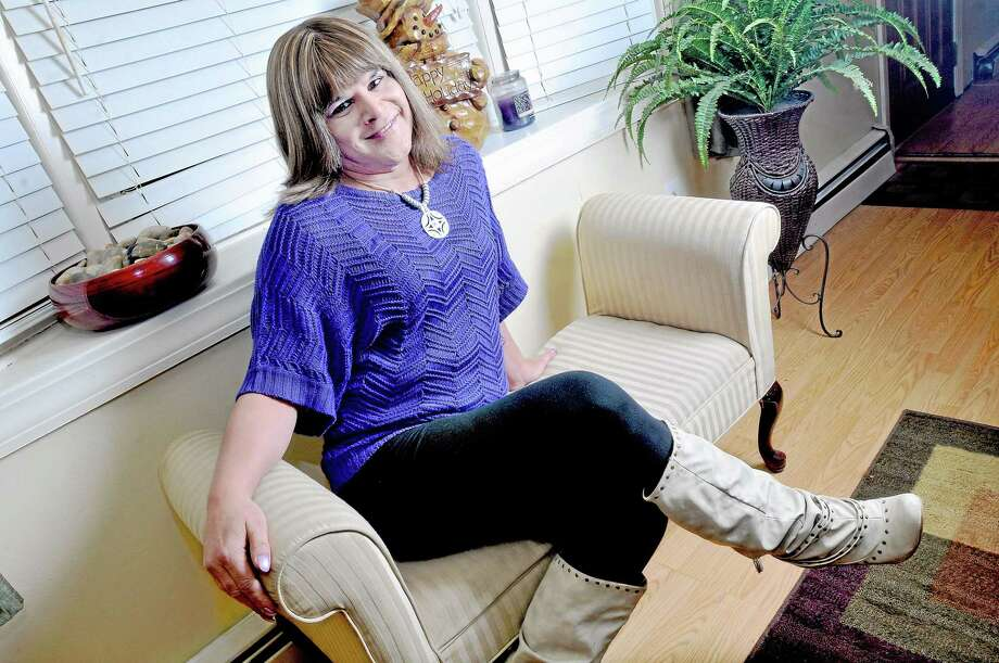 Middletown Police Officer Francesca Quaranta in her Newington home. Quaranta, who began working with the MPD in 2004 as Frank Quaranta, has filed a complaint against the Middletown Police Department to the Commission on Human Rights and Opportunities. Photo: Catherine Avalone - The Middletown Press   / TheMiddletownPress
