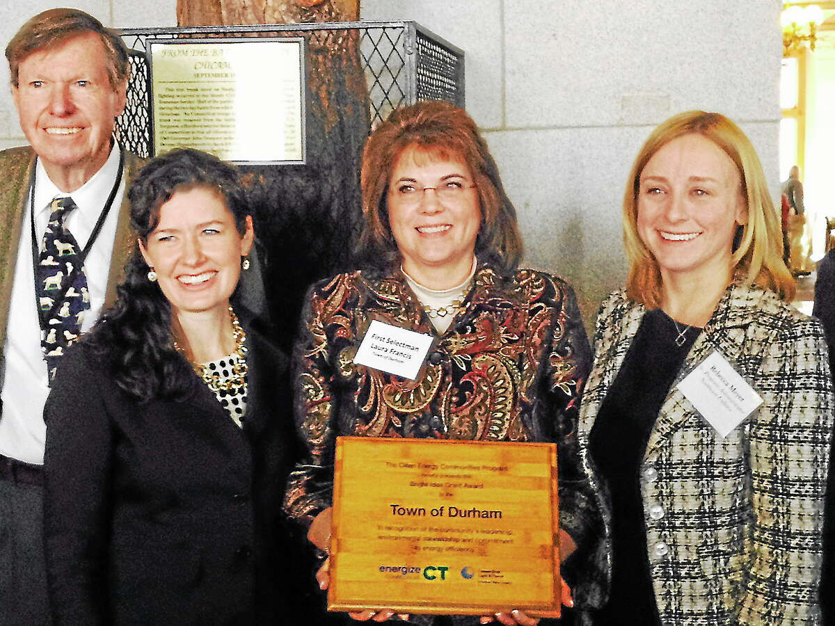 Durham First Selectwoman Laura Francis (center) accepts a $5,000 grant for Durham's clean-energy programs.
